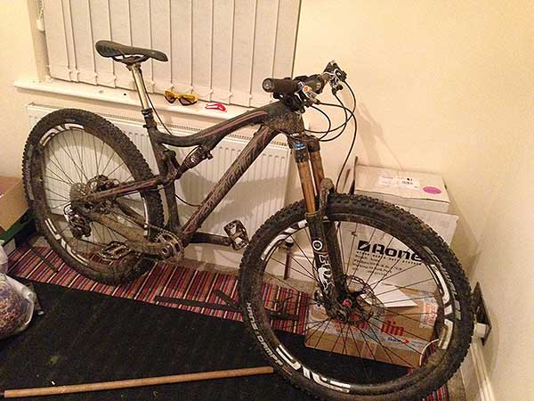 A muddy bike in a house