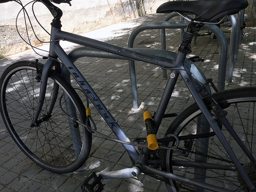 A bike locked with a cable and a U-lock