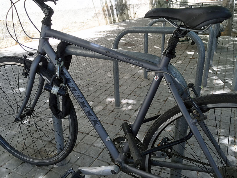 A bike locked with a chain and a U-lock