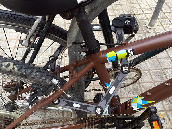 A folding lock securing two bikes
