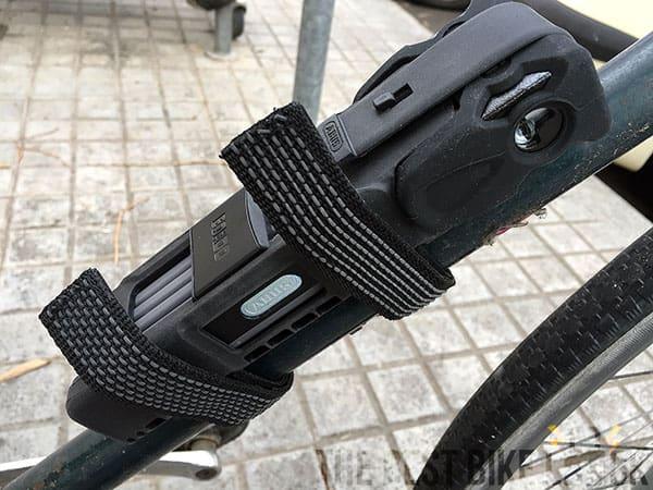 Folding lock frame mount velcroed around frame