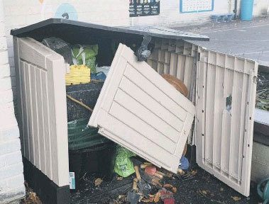 Damaged plastic shed