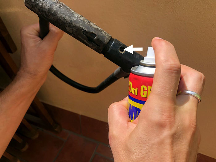 Step 2: Spray the problem area with WD-40