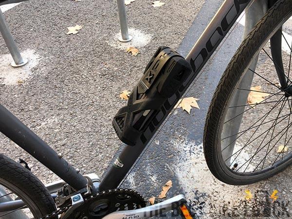 Folding lock in case on bike