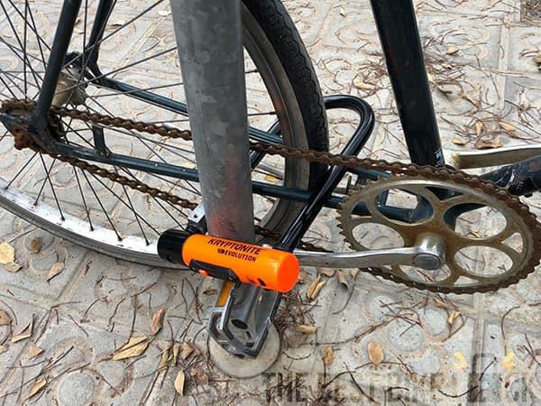 Kryptonite Evolution Standard around chain stays and rear wheel