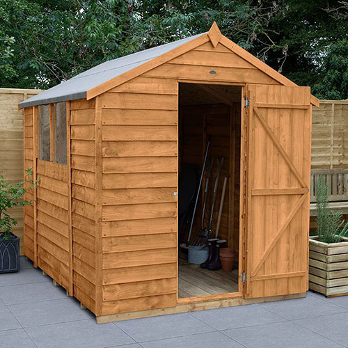 A wooden shed on a patio