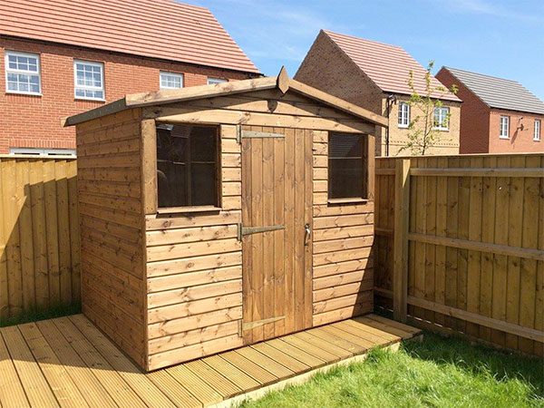 Wodden shed on timber decking